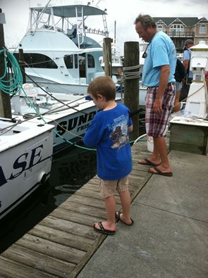Joe Kavanagh from Frisco Rod and Gun fishes hard for the Kid's Fishing Contest at this year's Day at the Docks!